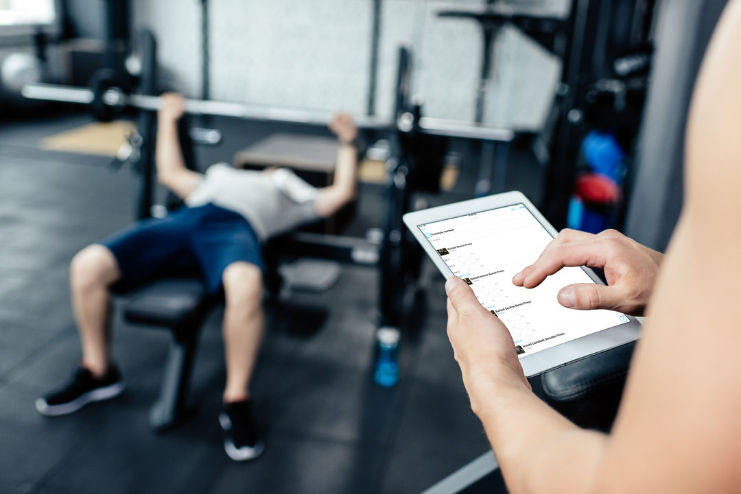 Personal trainer using Trainerize with an in-person client