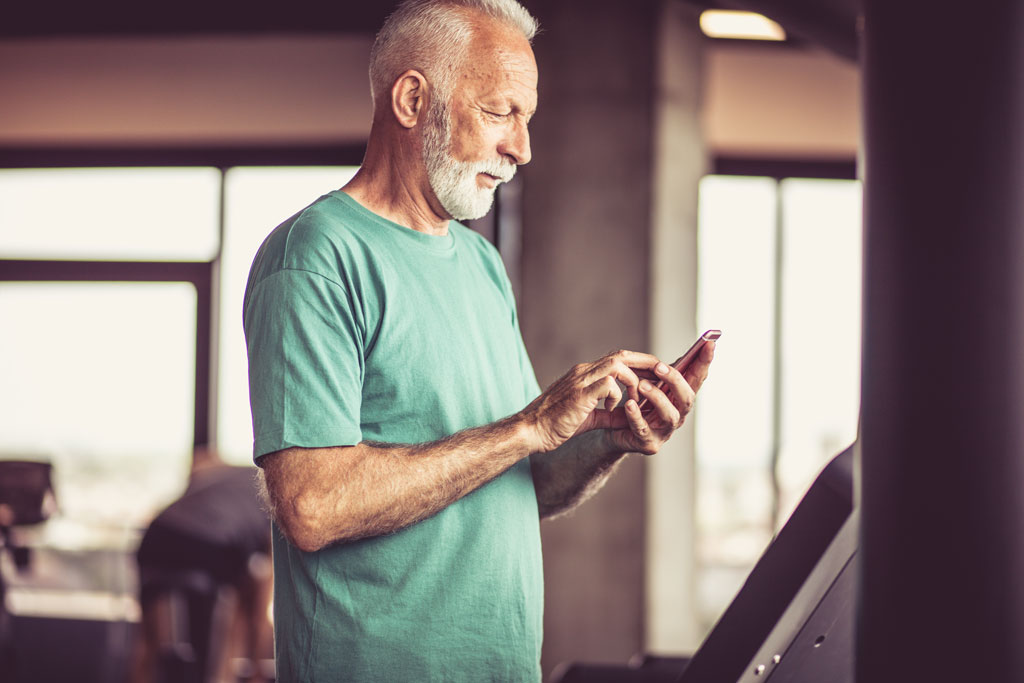 older adult using online personal training app